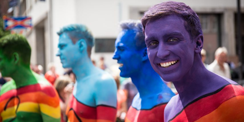 Picture of some guys in rainbow body painting