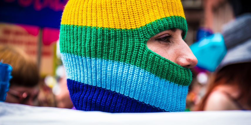 Picture of a woman covered in rainbow hood